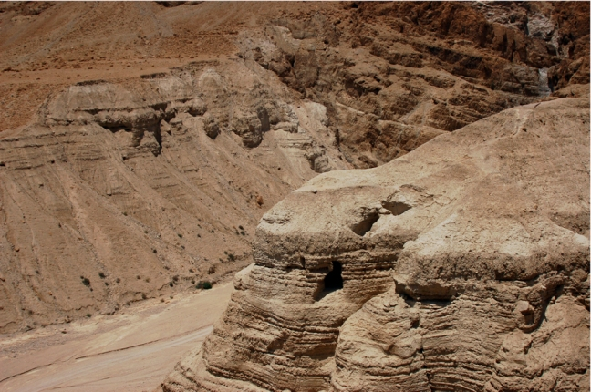Panorama photo of the wadi, the cliff, and cave 4 at Qumran.  © copyright holder of this work is Richard E. Oster.  Page 87, figure 49.
