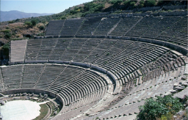Theater at Ephesus dated from the Hellenistic period but was expanded during the reign of the Roman Emperor Claudius. This theater had a seating capacity of approximately 25,000.  © copyright holder of this work is Richard E. Oster.