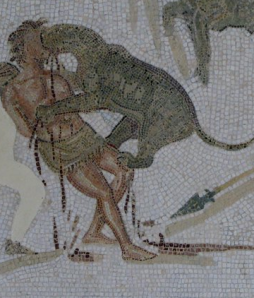 Mosaic of unarmed man attacked by animal, from El Djem, Tunisa.  Perhaps this victim was a criminal or a Christian.