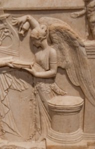 Nike offering libation, a liquid offering; located in Pergamum Museum, Berlin, Germany.  © copyright holder of this work is Richard E. Oster. Page 112, figure 66.