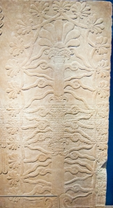 This image represent an Assyrian sacred tree, identified by some scholars with the idea of life. The idea of the sacred tree has a very long history in the art of the Ancient Near East and shares some similarities with the Jewish tree of life, from which the prophet John derives his ideas of the tree of life. These panels are located in the Brooklyn Museum, New York, New York.  © copyright holder of this work is Richard E. Oster. Page 114, figure 71.