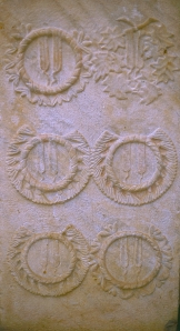 Monument from Ephesus depicting the several crowns awarded to an individual.  © copyright holder of this work is Richard E. Oster.Page 127, figure 77.